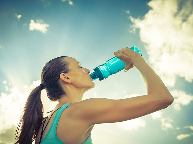 woman drink water polyester bottle